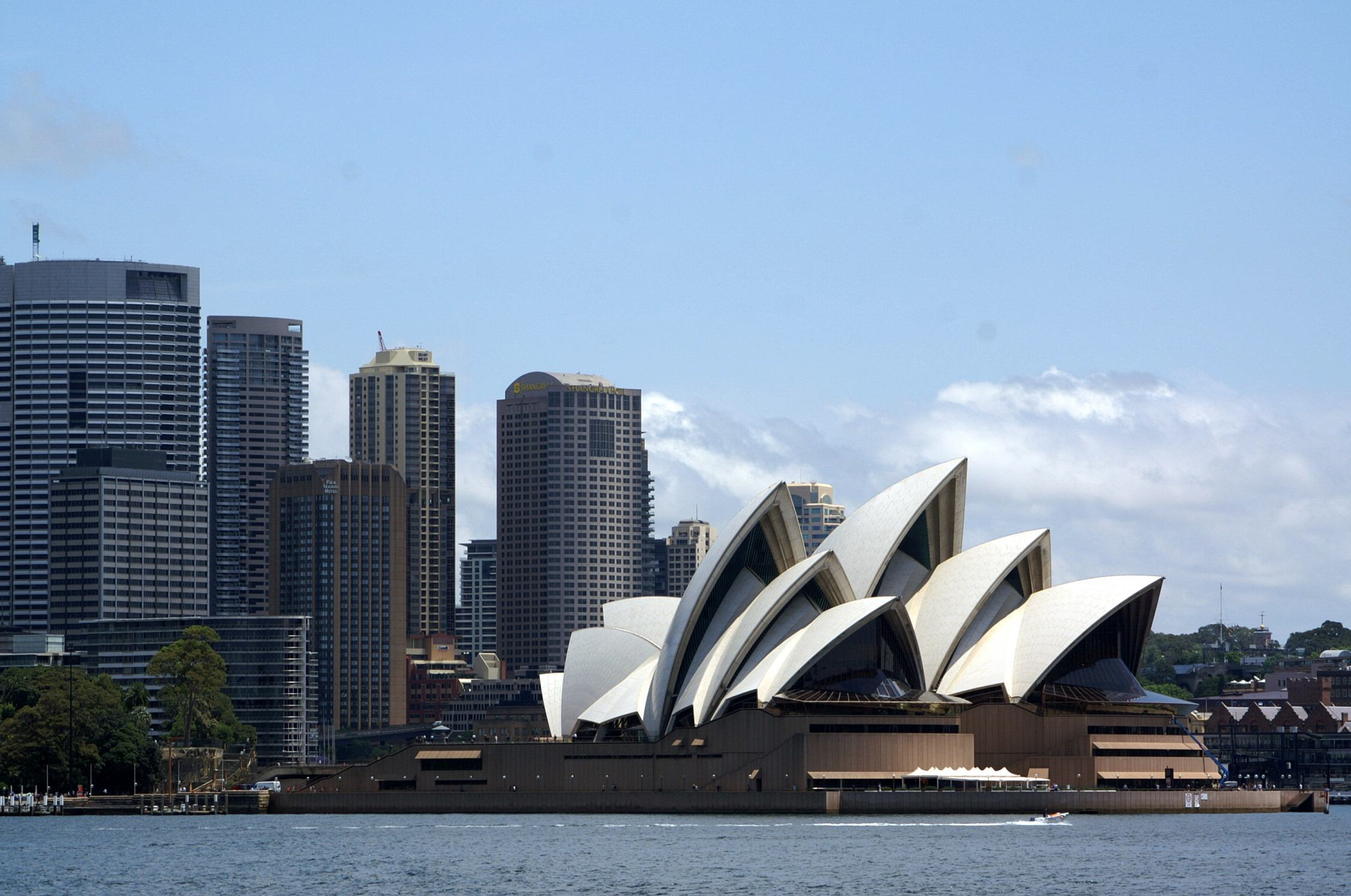 Sydney opera house as seen against the downtown towers from a harbour cruise