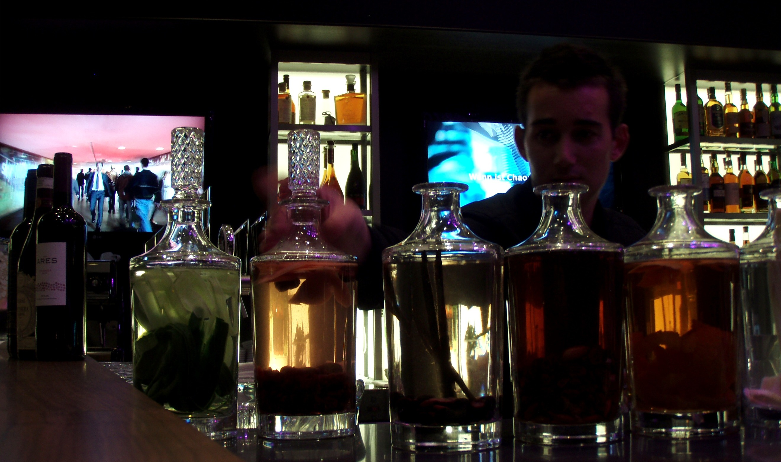 Renaissance Zurich Tower Hotel's Barman with stylish colorful bottles