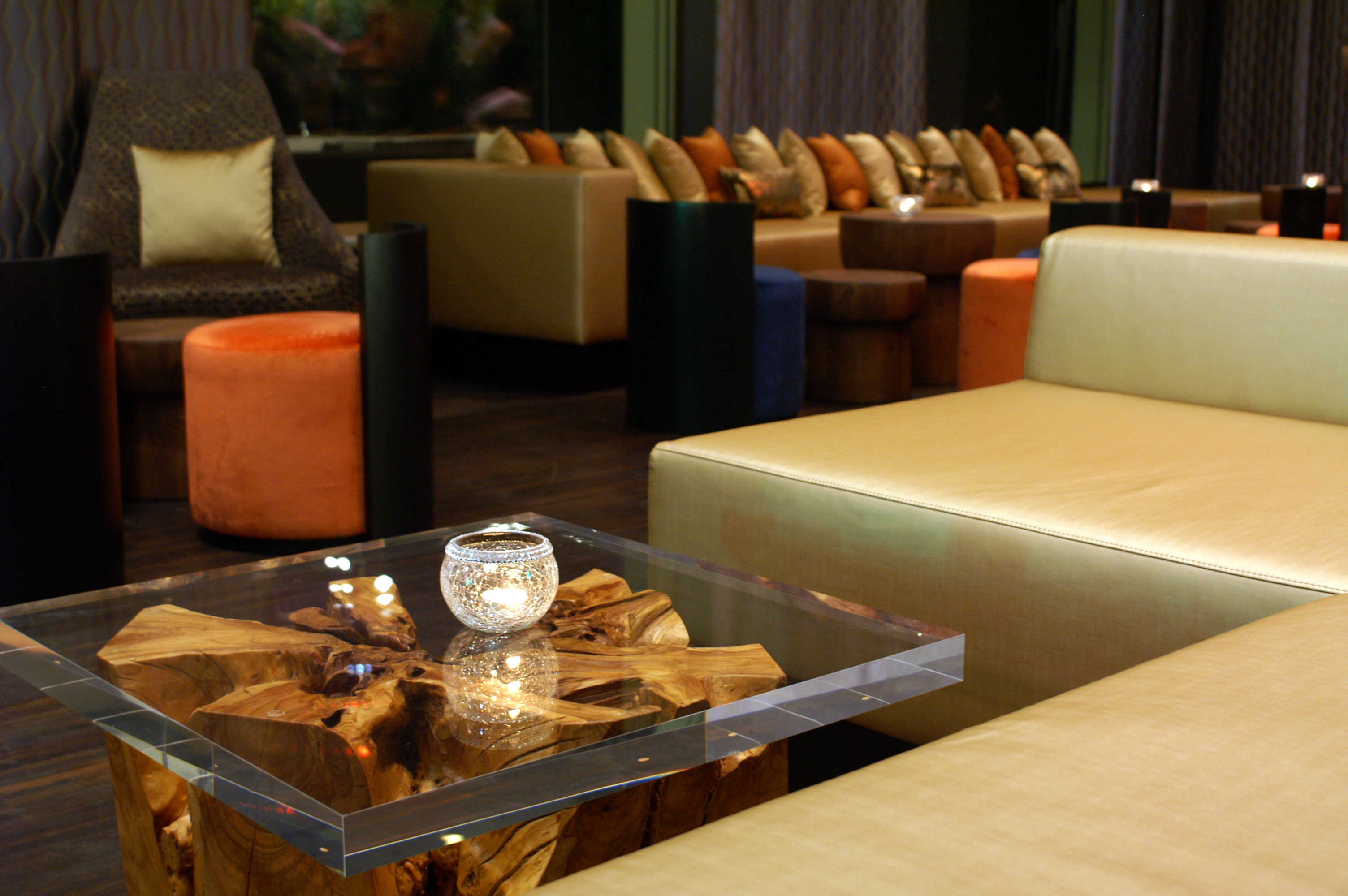 View of lounge table and couch pillows at the Renaissance Zurich Tower Hotel lobby.