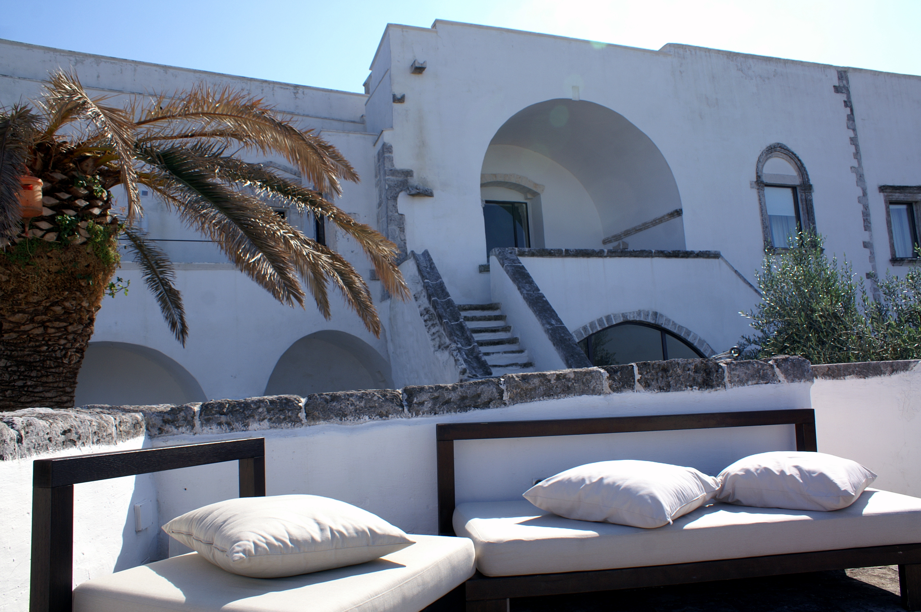 Outdoor lounge bed and cushions at the Sommita Relais hotel in Ostuni, Puglia