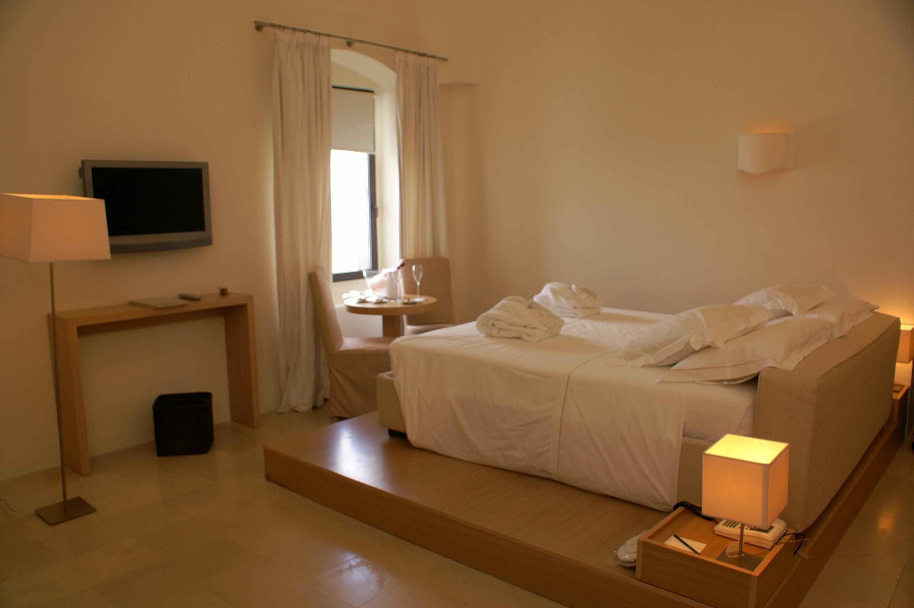Bed in La Sommita Relais hotel room in Ostuni, Puglia, Italy