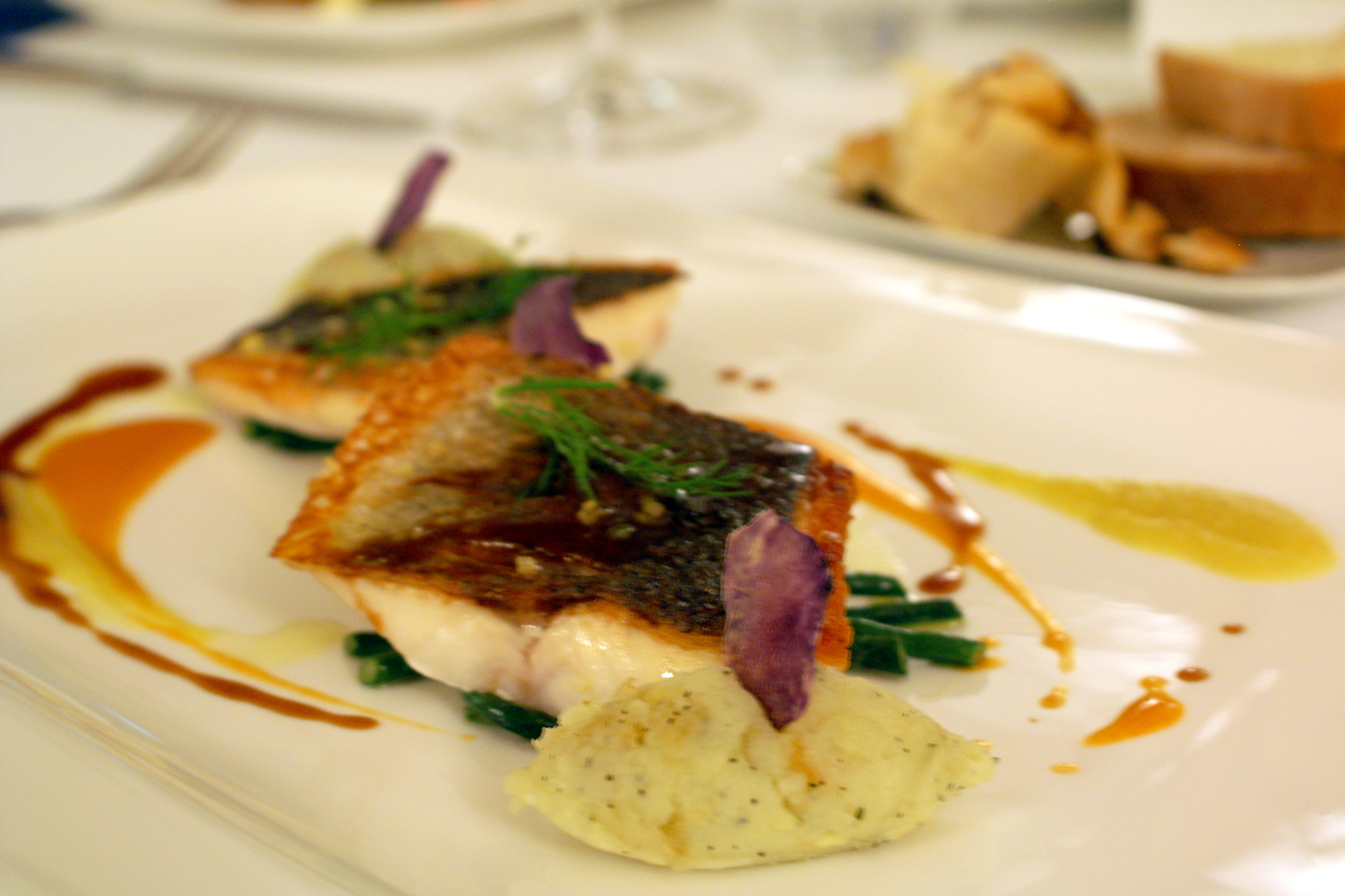 Sea bass cooked on the skin with salty lemon at La Sommità Relais hotel in Ostuni, Puglia