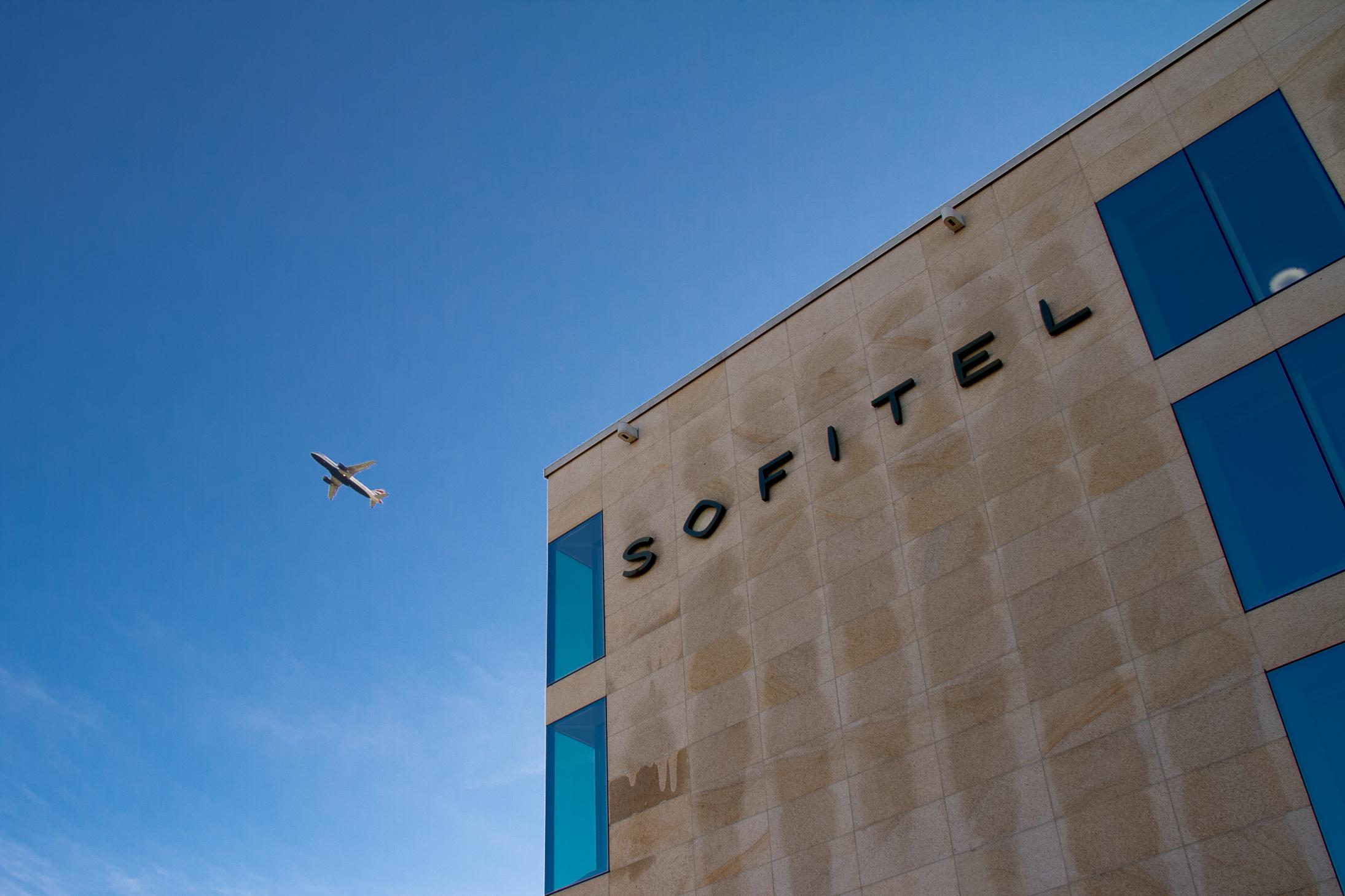 Airplane taking off right next to Sofitel hotel London Heathrow