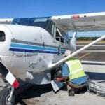 Michaela loading luggage into her Cessna