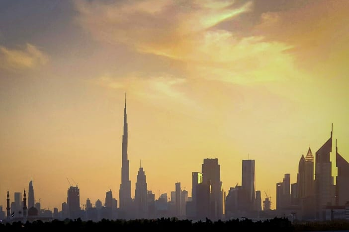 Dubai Skyline with Burj Khalifa and Emirates Towers at sunset